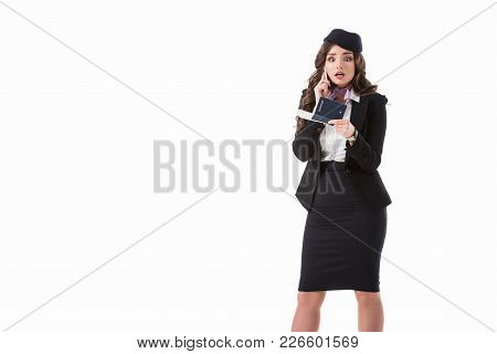 Shocked Stewardess Talking By Smartphone And Holding Passport Isolated On White