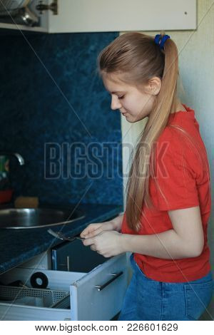 Teen Girl 14-years Old Is Washing Dishes At Kitchen, Red Shirt