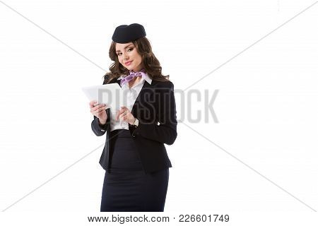 Beautiful Stewardess Using Tablet And Looking At Camera Isolated On White