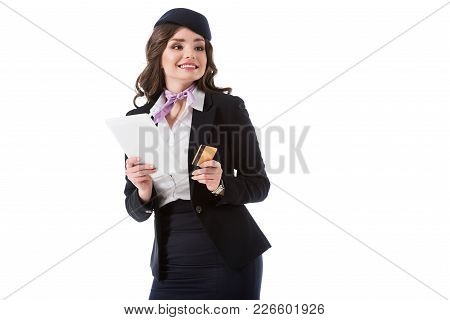 Smiling Attractive Stewardess Holding Tablet And Credit Card Isolated On White