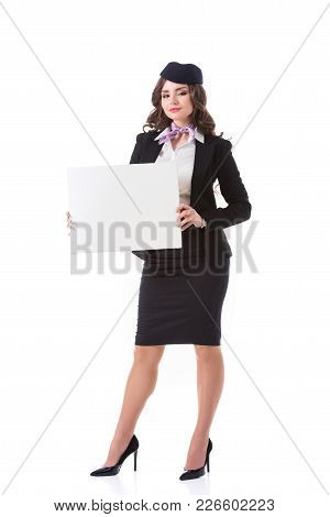 Attractive Stewardess Holding Empty Board Isolated On White