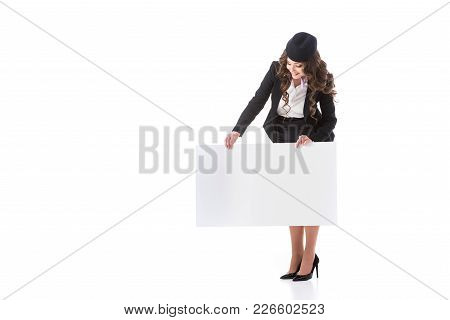Beautiful Stewardess Looking At Empty Board Isolated On White