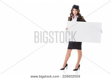 Attractive Smiling Stewardess With Empty Board Isolated On White
