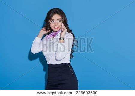 Attractive Stewardess Talking By Smartphone On Blue