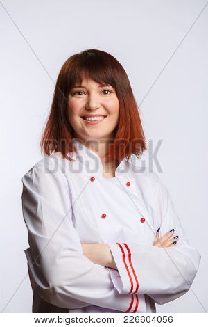 Image of female chef in white robe on empty background