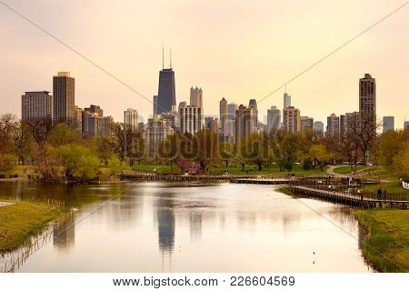 Chicago, Illinois, United States - May 08, 2011: Downtown Skyline And South Pond At Lincoln Park.