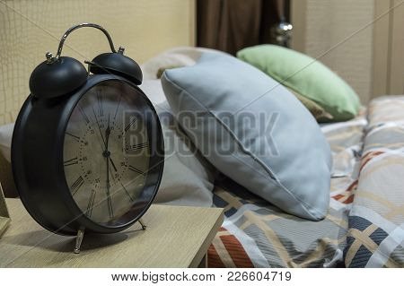 Black Alarm Clock On Table Place Near Bed