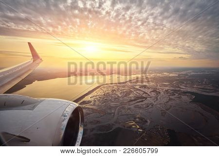 Aerial Sunrise Over Airplane Wing In Flight