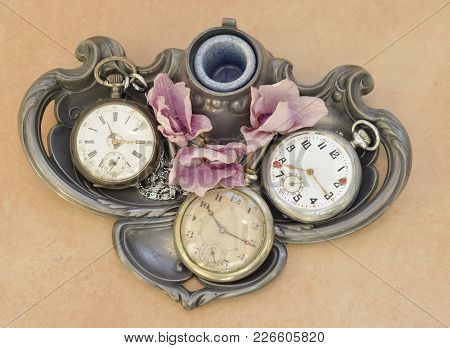 Old Vintage Pocket Antique Clock On A Metal Plate