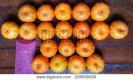 Background Of Ripe Mandarin Limes And Money Envelope On The Floor