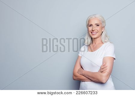 Portrait With Copy Space Of Cheerful, Happy, Aged, Mature, Nice Woman Standing With Crossed Arms Ove