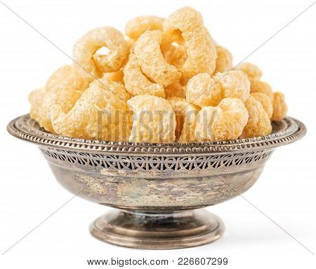 Antique Metal Bowl With Crunchy Pork Cracklings Isolated On White