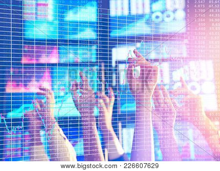 Stock exchange traders working in office
