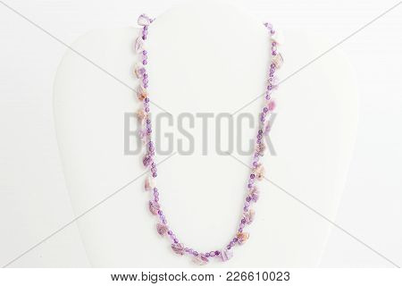 A Lavendar Necklace Constructed With Several Sizes Of Beads