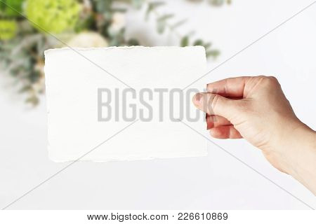 Styled Stock Photo. Feminine Wedding, Birthday Greeting Card Mockup Scene With Woman's Hand In Holdi