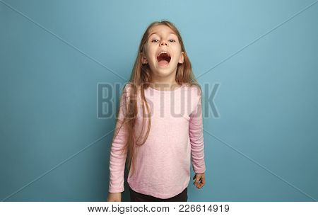 The Emotional Blonde Teen Girl Have A Happiness Look And Screaming. Studio Shot. The Surprise, Delig
