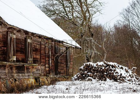 At The Old Deserted House Stands In The Pile Of Wood