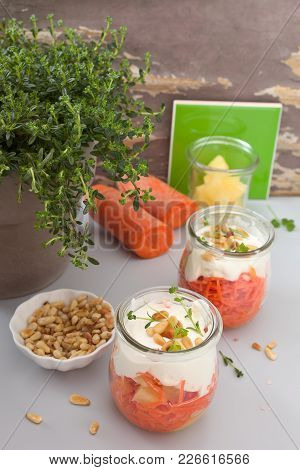Carrot Salat With Pineapple And Pine Nuts.