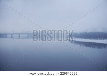 Panoramic View To Foggy Sunset Time On River Dnieper, Kiev. Kyiv, Ukraine. Forest Reflection In Wate