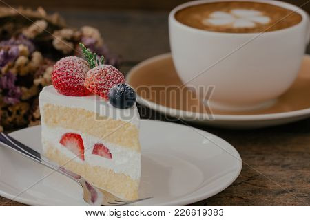 Homemade Delicious And Soft Strawberry Shortcake On Wood Table Served With Hot Cappuccino Coffee At