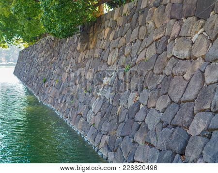 Stone Moat Wall Of The Japanese Imperial Palace Area In Downtown Tokyo Japan. Profile Of The Large F