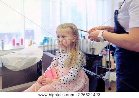 Little Girl In Barbershop