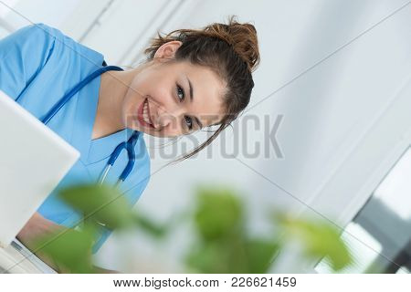 Portrait Of A Young And Smiling Female Doctor
