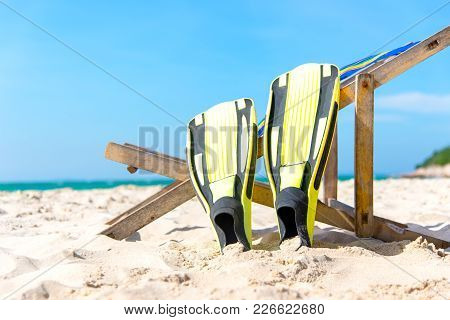 Summer Day.  Yellow Diving Fins Laying On The Beach, During Sunny Summer Day, Blue Sky Background. T