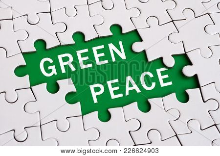 White Jigsaw Puzzle In Assembled State With Missing Elements Forming A Green Space With White Inscri