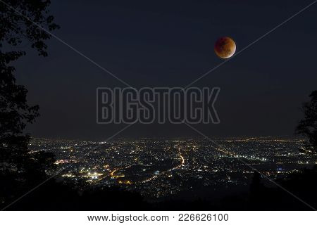 Lunar Eclipse Over Chiang Mai City. Blood Moon In The Lunar Eclipse And Also A Blue Moon And Super M