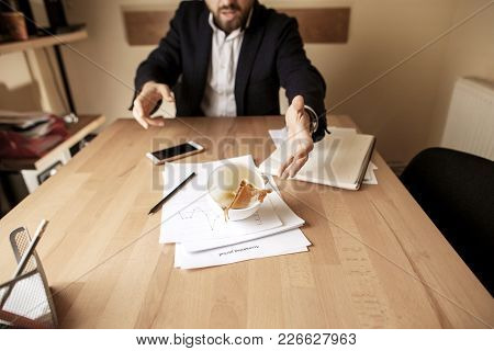 The Businessman And Coffee In White Cup Spilling In Slow Motion Or Movement On The Table With Docume