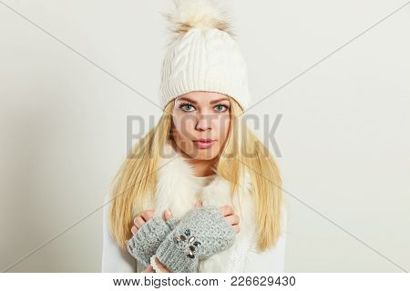 Winter Fashion. Young Blonde Woman Wearing Fashionable Wintertime Clothes White Fur Scarf, Woolen Ca