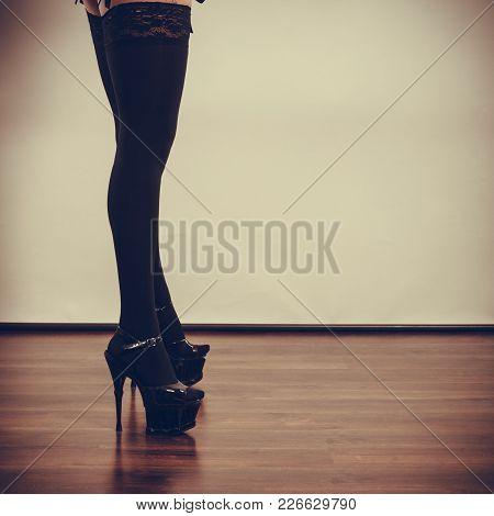 Sexuality Of Women. Part Body Woman Wearing Black Sexy Stockings. Long Female Legs In High Heels.