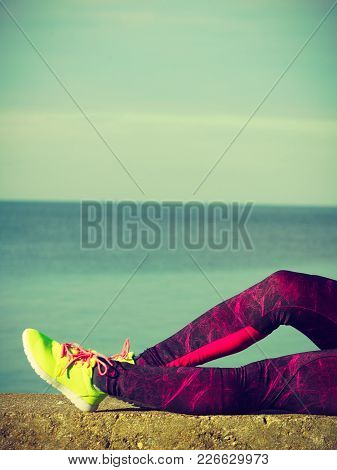 Woman Resting Relaxing After Doing Sports Outdoors. Fitness Girl Female Jogger Wearing Sporty Clothe
