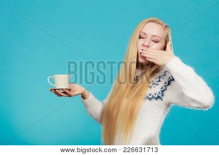 Addiction And Caffeine Need Concept. Sleepy Yawning Blonde Woman Holding Cup Of Coffee About To Drin