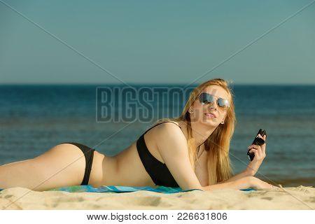 Summertime Pleasures, Enjoying Vacation Concept. Woman In Bikini Sunbathing And Relaxing On Beach, U