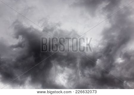 Thick Black Clouds As Background . In The Park In Nature