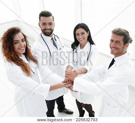 friendly team of doctors shows their success