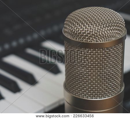 Piano Keyboard And Condenser Microphone. Concept Of Home Music Studio.