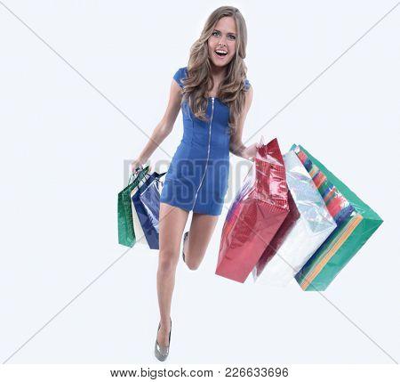 Fabulous woman shopper carrying her shopping bags as she walks o