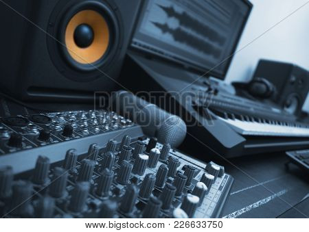 Mixer, Condenser Microphone And Professional Monitor. Concept Of Home Music Studio. Blue Styled.