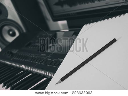 Piano Keyboard, Pen And Sheet. Concept Of Composing Song. Black And White.