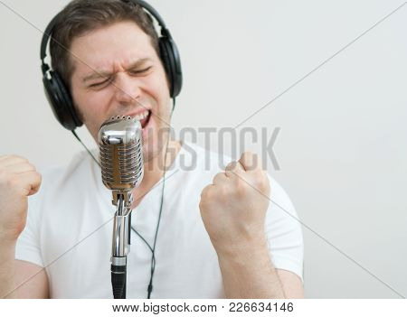 Handsome Man Recording A Song. Space For Your Text.