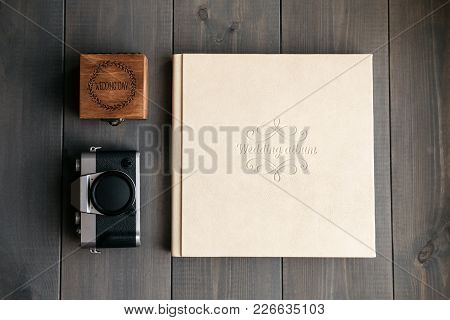 White Leather Wedding Album, Wooden Box With Inscription Wedding Day And Vintage Photo Camera. On Wo
