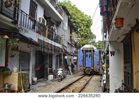 Hanoi, Vietnam - 16th December 2017. The 15.30 Train From Hanoi To Sapa As It Goes Along A Narrow Re