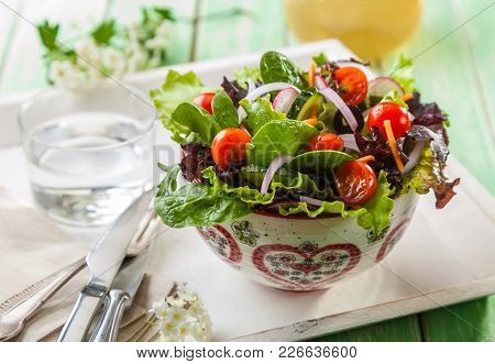 Fresh Summer Salad With Cherry Tomatoes, Spinach, Arugula, Romaine And Lettuce On Dark Wooden Backgr