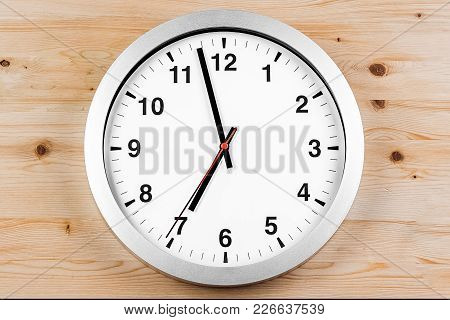 It's Seven O'clock Already, Time To Wake Up For Breakfast, Modern White Metallic Alarm Clock On Wood