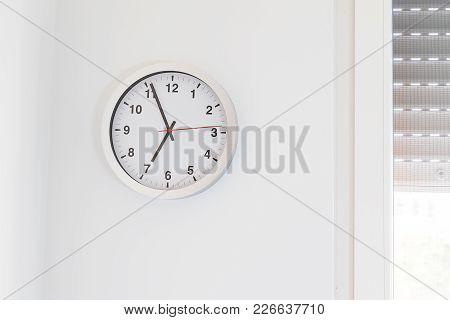 It's Seven O'clock Already, Time To Wake Up For Breakfast, Modern White Metallic Alarm Clock On Mode