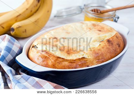 Casserole Of Cottage Cheese With Raisins On Background