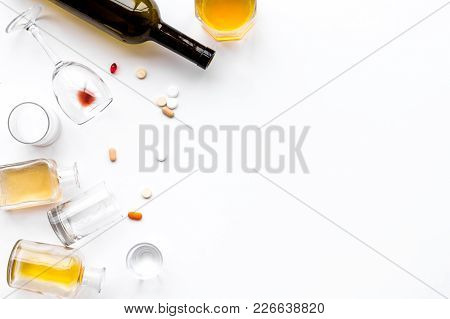 Alocohol Abuse And Alcoholism Treatment Concept. Glasses, Bottles And Medcine Pills On White Backgro
